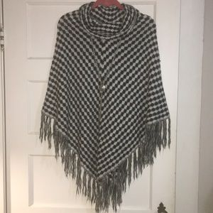 Black and white sweater poncho.